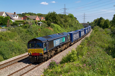 66427 passes Portskewett with 4V38 08.22 Daventry to Wentloog 'Tesco Express'. Friday 27th July 2012.
