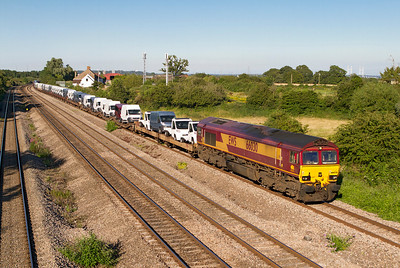 66030 passes Undy in charge of 6X52 17.33 Portbury Docks to Mossend loaded cars. Tuesday 24th July 2012.