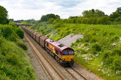 6O32 10.47 Margam to Dollands Moor loaded steel with 66040 in charge climbs through Chipping Sodbury Cutting towards the tunnel. Wednesday 20th June 2012.