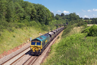 66555 heads away from Wickwar Tunnel with 4V06 08.30 Ratcliffe Power Station to Stoke Gifford Yard empty hoppers. Wednesday 25th July 2012.