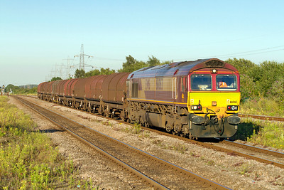 66063 passes Severn Tunnel Junction with 6V07 14.52 Round Oak to Margam empty steel. Tuesday 24th July 2012.