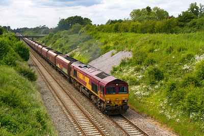 66112 struggles up the 1 in 300 gradient with 6D15 Avonmouth BHT to Didcot Power Station loaded coal having just emerged from Chipping Sodbury Loop. Wednesday 20th June 2012.