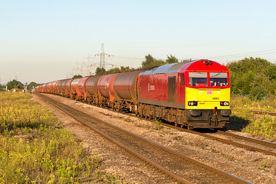 With it's train of empty tanks draped over the changing gradient 60063 powers past Severn Tuneel Junction with 6B47 18.20 Westerleigh to Robeston. Tuesday 24th July 2012.