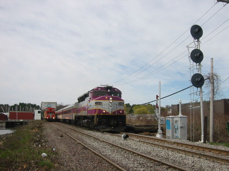 Here a Rockport bound train passes the work train train wrong iron at Mancester By The Sea.