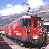 MGB motor luggage van 54 stands at Andermatt waiting to depart propelling R535 11:12 Göschenen to Visp service, 30/7/2012.