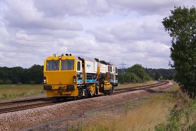 DR 77801 - Matisa R 24 S regulator in VolkerRail colours, passes Slitting Mill on 27/08/10.