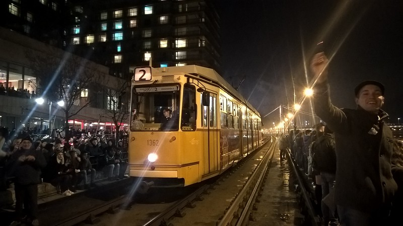 Count down to midnight on New Years Eve 2017 in Budapest and the riverside trams are brought to a halt by a seething mass of revelers - probably expecting better fireworks on the Danube than there were.