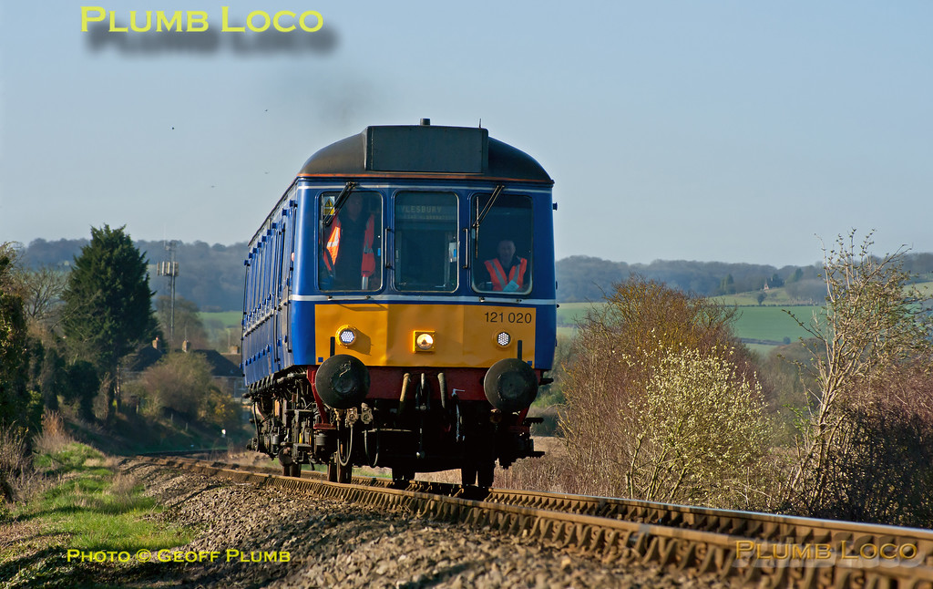 On another gorgeous March morning, Chiltern's blue bubble car 121 020 is departing from Princes Risborough as 2A16, the 09:24 to Aylesbury, approaching the Church Path foot-crossing at 09:26 on Tuesday 27th March 2012. Digital Image No. GMPI11366.