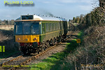 "Chiltern ""Bubblecar"" No. 121 034 has just departed from Princes Risborough as 2A16, the 09:24 to Aylesbury and has just passed the foot-crossing by Park Mill Farm at 09:25 on Tuesday 20th March 2012. Digital Image No. GMPI11302."