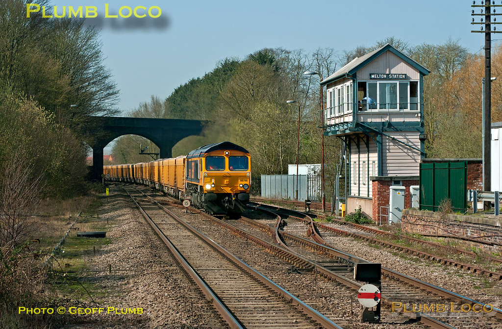 GBRf 66746 is about to pass Melton Station signalbox as it approaches Melton Mowbray station with 6L24, the 10:34 Mountsorrel to Whitemoor VQ loaded ballast train, at 12:07 on the lovely afternoon of Wednesday 28th March 2012. Digital Image No. GMPI11416.