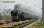 "Once again it was as dull as ditchwater on the early morning of Saturday 3rd March 2012. Racing out of the gloom at 08:06 is BR Standard ""Britannia"" No. 70013 ""Oliver Cromwell"" at the head of 1Z54, ""The Lincolnshire Poacher"", 07:12 from King's Cross to Cleethorpes, going great guns on the down fast line at Arlesey foot-crossing. Digital Image No. GMPI11201."
