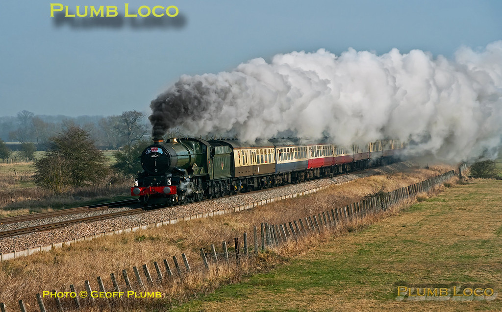 "After stopping for water at Challow 6024 ""King Edward I"" continued its journey in glorious light, the sun having burnt off the mist. Going in fine style the train approaches Shrivenham at 11:54 on Thursday 1st March 2012. This was 1Z27, ""The Cathedrals Express St.David's Day/Help for Heroes"" special, 09:36 from Paddington to Cardiff and return to Euston. Digital Image No. GMPI11178."