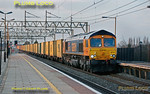 GBRf 66710 is at the head of 4L22, 15:21 Hams Hall - Felixstowe intermodal as it passes southbound through Cheddington station at 17:13 in the last rays of sunshine on Thursday 1st March 2012. Digital Image No. GMPI11194.