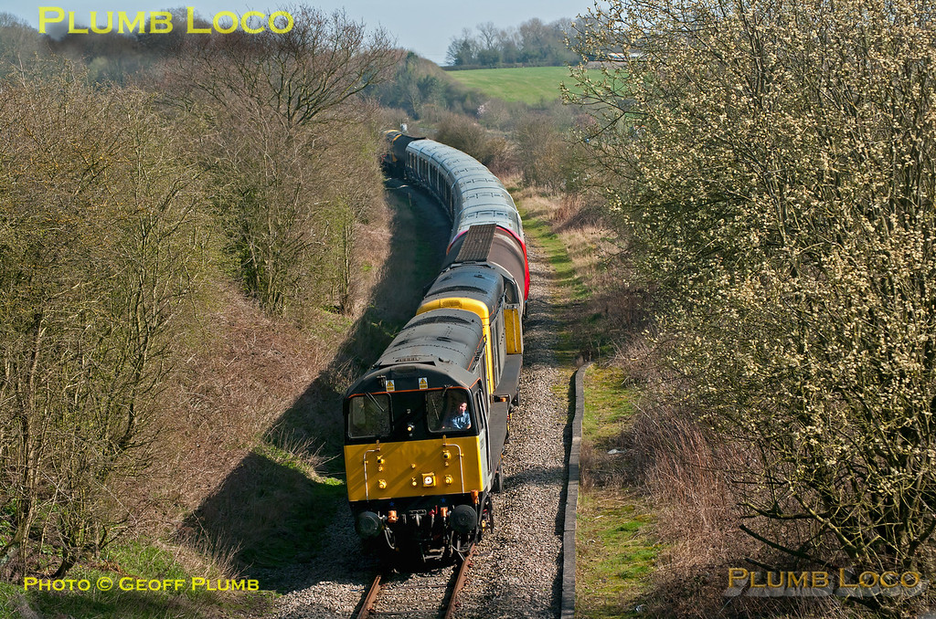 """The train having reversed at Knighton Junction, 20901 and 20905 are now leading, with 20227 and 20142 on the rear as 7X09 traverses the little used line between Coalville and Branston Junction near Coleorton, with a set of LUL """"S"""" Stock for delivery from Old Dalby test track to Neasden Depot. The train is now running around 30 minutes late at 14:45 on Wednesday 28th March 2012. I haven't been to this location for some time and tree growth now restricts photo options to a more or less head-on shot... Digital Image No. GMPI11468."""