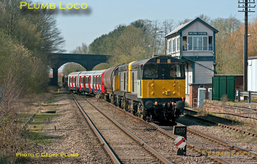 "With 20227 and 20142 leading, 20901 and 20905 bring up the rear of the train as 7X09 departs from Melton Mowbray, having reversed in the loop east of the station. This is the 11:42 from Old Dalby (Asfordby) test centre to Amersham and Neasden Depot, delivering another set of LUL ""S"" stock. I had missed seeing it depart from Asfordby as it left an hour early, but is now running a few minutes late after being delayed at Melton, 12:46, Wednesday 28th March 2012. Digital Image No. GMPI11458."