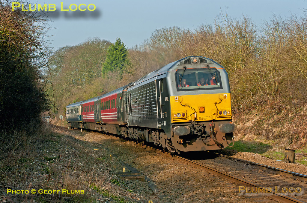 """67012 """"A Shropshire Lad"""" has just passed Little Kimble station with 5Z67, the 14:58 ECS working from Aylesbury DMUD to Wembley LMD via Greenford and Acton Wells. The three coaches, numbers 12094, 12017 and 12043, had been at Aylesbury for tyre-turning on the wheel lathe. 15:08, Thursday 15th March 2012. Photo taken from a public footpath across the line. Digital Image No. GMPI11296."""