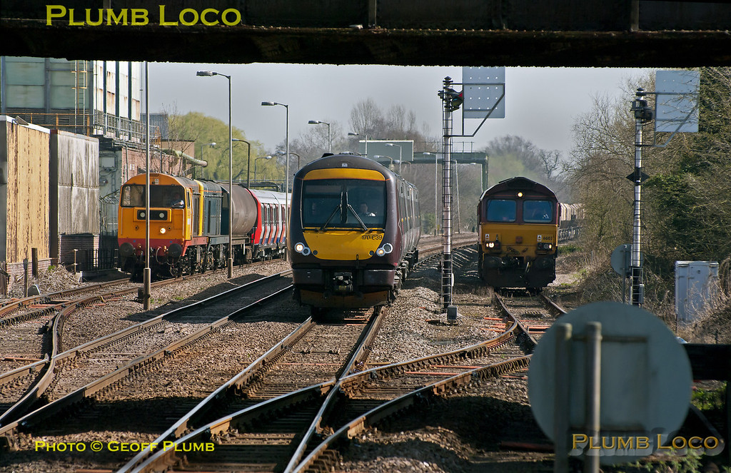 "On the left in the up loop at Melton Mowbray 20227 and 20142 are waiting departure time with 7X09, 11:42 from Old Dalby to Neasden delivery of a new LUL ""S"" stock unit, in the centre is CrossCountry 170 639 arriving with a Birmingham bound working and on the right in the down loop is 66103 (with 66150 hidden behind it). This train was 6D28, the 02:12 from Elstow to Mountsorrel empty four wheel hopper wagons. It departed 64 minutes early from Elstow and was 78 minutes early by Sharnbrook Junction. It reached Manton Junction 12 minutes early but was 144 minutes late at Oakham! The train then lingered in the loop at Langham and was rescued eventually by 66103, the train was 533 minutes late by the time it departed from Melton... 12:30, Wednesday 28th March 2012. Digital Image No. GMPI11428."