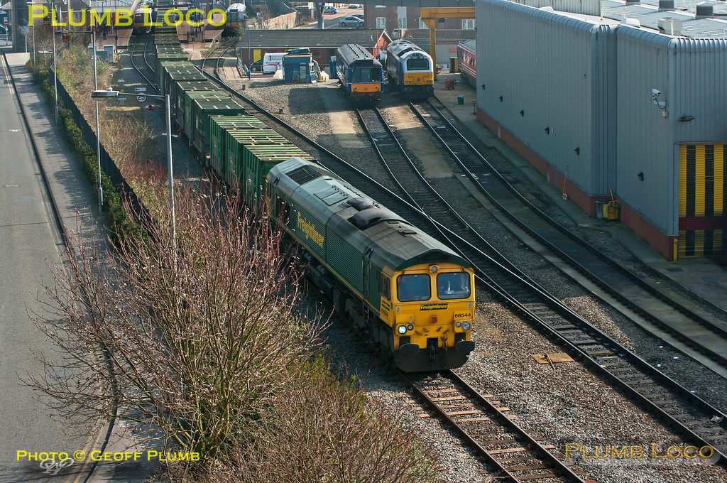 "Freightliner 66544 passes Aylesbury DMUD with 6M22, the 08:21 Cricklewood to Calvert ""Binliner"" at 12:46 on Thursday 15th March 2012. Stabled in the sidings alongside the depot are bubblecar 121 020 and 67012""A Shropshire Lad"". 121 034 can be seen in the station, also a 165 unit soon to depart for Marylebone via Amersham. Digital Image No. GMPI11261."