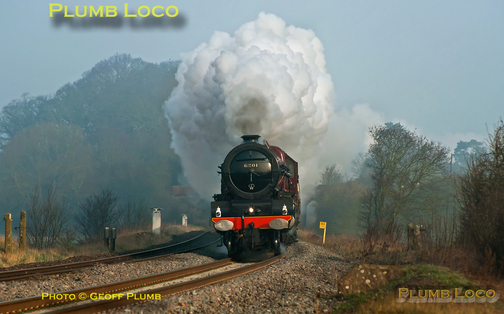 "LMS Stanier ""Princess"" Class 4-6-2 No. 6201 ""Princess Elizabeth"" is in full cry as it approaches King's Sutton with 1Z64, ""The Double Lickey Banker"", 07:05 from Solihull to Bristol via Oxford and Swindon, returning via Worcester and the Lickey Incline. The morning mist had still not fully cleared as the train nears the foot-crossing at 07:49 on Saturday 24th March 2012. Digital Image No. GMPI11343."