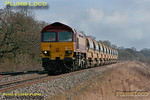DBS 59203 bowls westwards along the GWML approaching the foot-crossing just east of Wantage Road, hauling 6W24, the 10:28 from Hinksey Yard to East Somerset Junction train of Railtrack branded ballast hoppers. 10:47, Saturday 3rd March 2012. Digital Image No. GMPI11206.