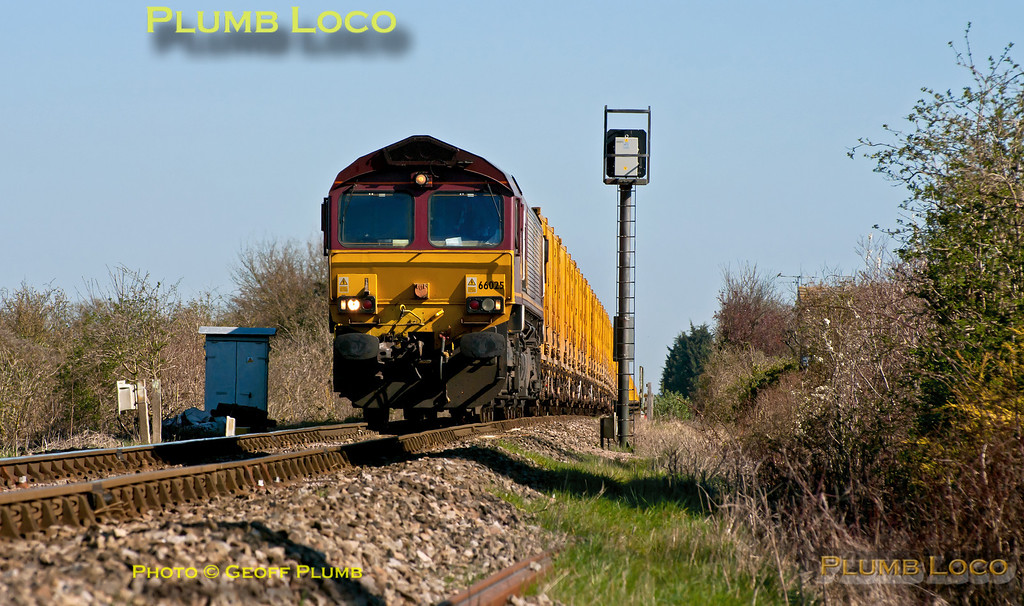 """66025 approaches the foot-crossing at Church Path, Princes Risborough, at the head of 6A58, the 10:14 from Calvert to Northolt empty """"binliner"""" train at 10:57 on the lovely morning of Tuesday 27th March 2012. Digital Image No. GMPI11376."""
