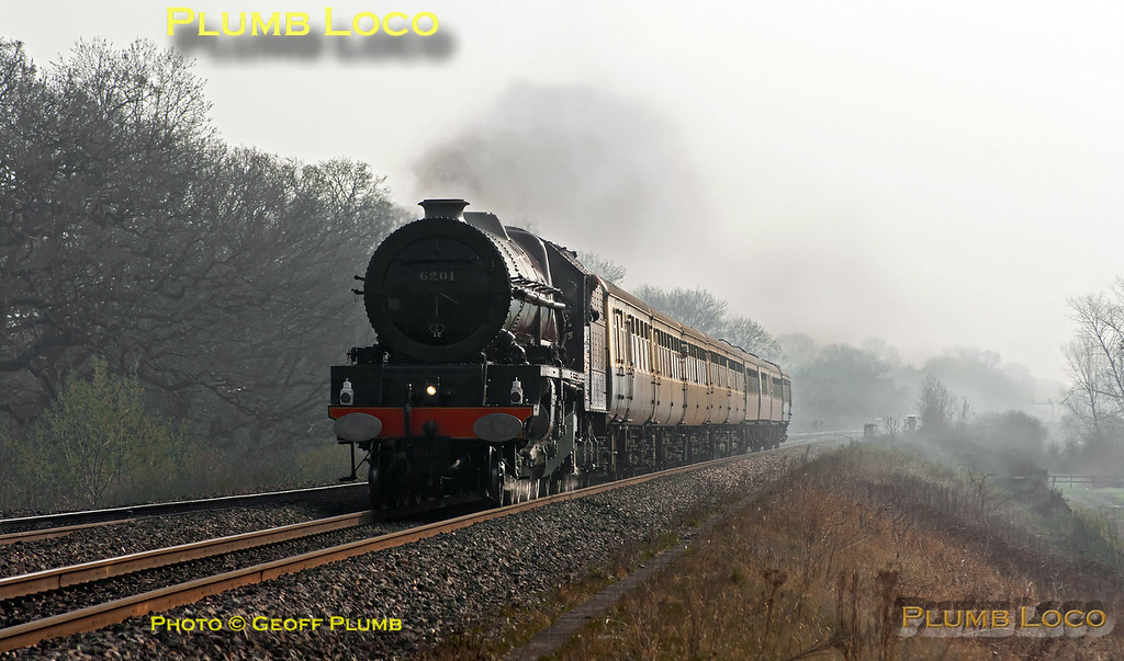 "Much of the mist had gone, but much haze remained as 6201 ""Princess Elizabeth"" heads west along the GWML, approaching the foot-crossing east of Wantage Road. I was hoping that as the train was not scheduled to stop for water at Challow it would be routed along the down main line, but sadly it was looped and so has shut off to take the turnout. This was 1Z64, the 07:05 from Solihull to Bristol ""The Double Lickey Banker"" returning via Worcester and the Lickey Incline. 09:14, Saturday 24th March 2012. Digital Image No. GMPI11353."