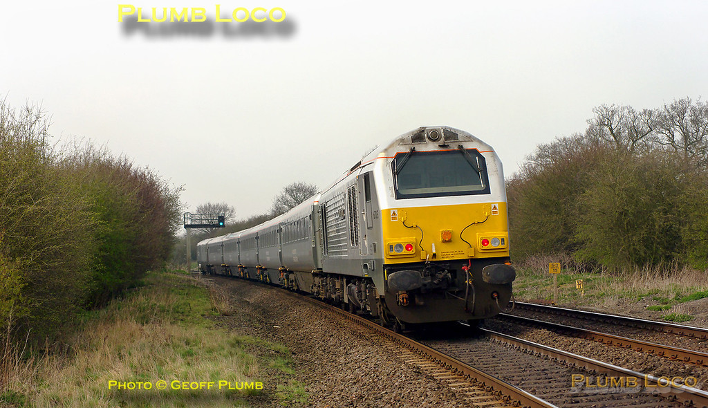 """67015 """"David J. Lloyd"""" is providing the power on the rear of 5R67, the 13:43 driver-training run from Marylebone to Birmingham Moor Street for Chiltern LHCS services. 15:04, Tuesday 29th March 2011. Digital Image No. GMPI8340."""