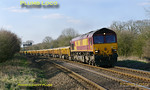 DBS (EWS) 66030 approaching the foot-crossing at Wormleighton with 6Z27, the 11:56 from Stud Farm to Hinksey VQ loaded ballast wagons. 15:27, Wednesday 23rd March 2011. Digital Image No. GMPI8275.