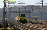 Freightliner 70007 has just emerged from the tunnel at Linslade and is powering past Old Linslade with 4M45, the 03:09 from Felixstowe to Ditton freightliner train, running somewhat late at 08:02 on Saturday 19th March 2011. Digital Image No. GMPI8213.