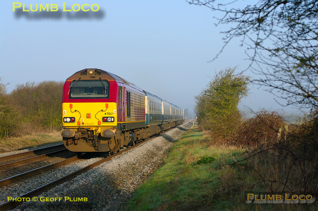 67001 is once again at the head of 1H08, the 06:53 Chiltern LHCS service from Banbury to Marylebone, with DVT 82302 on the rear of the six coaches. The train is about to pass the foot-crossing near Kingsey at 07:25 on the glorious morning of Wednesday 23rd March 2011. Digital Image No. GMPI8251.