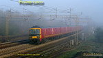 Early morning mist had still not cleared on the frosty morning of Thursday 24th March 2011, though the sun was doing its best. 325 004 brings up the rear of 1F00, the 06:40 Royal Mail working from Willesden PRDC to Warrington RMT, passing Old Linslade at 07:04, running somewhat early on the down slow line. Digital Image No. GMPI8282.