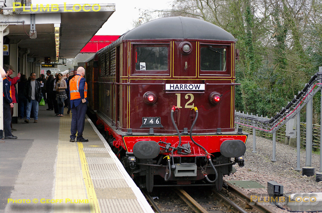 "Metropolitan electric loco No. 12 ""Sarah Siddons"" sits in platform 1 at Amersham station having arrived with train 746 from Harrow-on-the-Hill, a special for retired LT staff members. The train consisted of the 4TC set painted in mock teak livery with Class 20s Nos. 20227 and 20189 on the other end. The train is about to reverse to retrace its steps to Harrow and was then due to repeat the run to Amersham. In the event, the second run was curtailed at Rickmansworth due to a points failure at Chalfont... 11:51, Wednesday 30th March 2011. Digital Image No. GMPI8381."