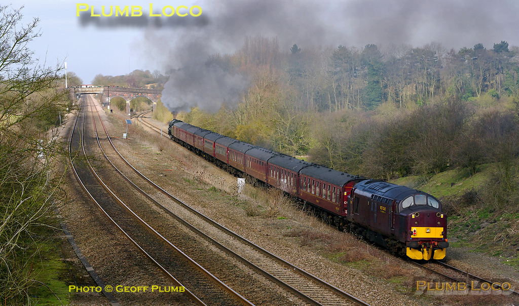 "On its first outing for some time after boiler repairs, ""Britannia"" class 4-6-2 No. 70013 ""Oliver Cromwell"" is hard at work on the climb to Sharnbrook summit as it approaches Souldrop with 37706 tagged on the back of the 10 coach train. This is 1Z48, ""The Lincoln Imp"", 08:15 from London Victoria to Lincoln. It is running on time at 10:49 on what used to be the double track slow lines, now a single bi-directional line at this point. Saturday 12th March 2011. Digital Image No. GMPI8179."