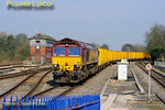 "On a glorious Spring morning 66182 brings 6A58, the 10:16 Calvert to Northolt empty ""binliner"" train, off the branch from Aylesbury into Princes Risborough at 11:04 on Friday 25th March 2011. Digital Image No. GMPI8318."