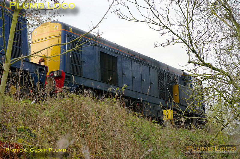 """20302 and 20301 are the locos on one end of of 8X09, while 20304 and 20305 were on the other end. This train is the move of new LUL """"S"""" Stock from Old Dalby to Amersham and Neasden and normally reverses at Princes Risborough at around 23:35. The train ran on Wednesday 30th March 2011, but apparently there was a loco failure at Princes Risborough so the whole train was stabled on the stub of the Thame branch in order to get it out of the way until the train could be rescued. The locos are seen shut down alongside the 0½ milepost on the Thame branch - not the easiest of spots to get any photos... 10:57, Thursday 31st March 2011. Digital Image No. GMPI8406."""