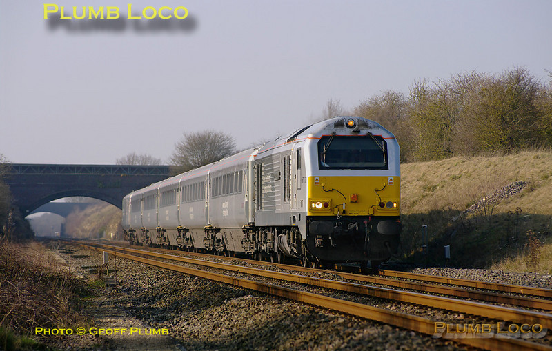 """In anticipation of further diagrams to be operated by LHCS, Chiltern Railways are operating some crew training runs, echoing earlier training runs for WSMR. 67013 """"Dyfrbont Pontcysyllte"""" is at the head of 5Z54, the 13:43 from Birmingham Moor Street to Bicester North, with a five coach set and DVT 82301 on the rear. The train is passing Ardley Quarry at 15:01, running a few minutes early. It then worked back from Bicester North at 15:20 as 5Z56 to Birmingham Moor Street. Tuesday 8th March 2011. Digital Image No. GMPI8132."""