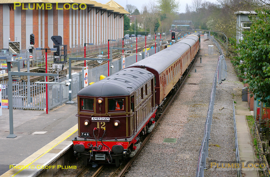 "Metropolitan Electric No. 12 ""Sarah Siddons"" is at the head of train 746, a special run for retired LT staff members on Wednesday 30th March 2011. The train consists of the 4TC set painted in mock teak livery with Class 20s Nos. 20227 and 20189 on the rear. It is entering Amersham station at 11:48, due at 11:42. It ran earlier as ECS from Ruislip depot to Neasden Depot before returning to Harrow-on-the-Hill to pick up its passengers and then performed two round trips to Amersham and back to Harrow, before finally returning to Ruislip depot. Digital Image No. GMPI8379."