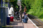 Passengers on the platform at Islip station await the arrival of the first Chiltern Railways service from Bicester Town to Oxford on the morning of Sunday 22nd May 2011. From this date Chiltern took over the service from First Great Western, the initial train from Bicester Town being the 10:04 departure, due to arrive at Islip at 10:16. Digital Image No. GMPI9167.