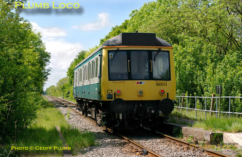 Chiltern 960 014 is working back from Claydon LNE Junction for the second time of the day with 5Z68, crew training runs from Aylesbury to Claydon, Bicester and Oxford. It has just passed the level-crossing at Launton on the former Oxford to Cambridge line at 12:57 on Monday 9th May 2011. The remains of the former station platform can be seen to the right of the unit. Digital Image No. GMPI8904.