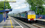 DRS 47810 is double-heading with 47501 as they race through Kings Sutton some twenty minutes early with 1Z49, the 05:45 Glasgow Central to Southampton Eastern Docks cruise liner special. 11:56, Monday 9th May 2011. Digital Image No. GMPI8895.