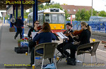"Hardly the everyday scene, even on Chiltern Railways! To mark the inaugural runs of the green ""bubblecar"" 121 034, and also for the formal opening of the new waiting room and other facilities at Princes Risborough station, the ""Buckinghamshire Quartet"" entertain guests and the public on the morning of Wednesday 25th May 2011. Digital Image No. GMPI9270."