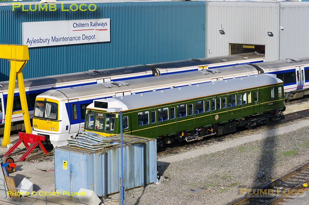 "Chiltern's newly refurbished ""bubblecar"", 121 034, sits in the sun outside Aylesbury depot, with the tantalising destination of ""Oxford"" on its route blinds, raising hopes it would be working the crew training runs later the same day. In the event, this was operated by 960 014... 08:03, Monday 9th May 2011. Digital Image No. GMPI8879."