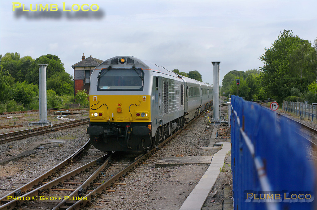 """From the start of the new Chiltern timetable on 23rd May 2011, more trains are now operated by LHCS and not just in peak hours. 67013 """"Dyfrbont Pontcysyllte"""" is hot on the heels of 67015 as it works 1H09, the 06:14 from Birmingham Moor Street to Marylebone, non-stop from Banbury. It has a five coach ex-WSMR set with DVT 82303 on the rear. It looks like all the former WSMR locos and coaches have now lost their W&S branding. The train is approaching Princes Risborough station at 07:42 and passing between the stanchions for the new signal gantry that appeared over the previous weekend. The view will be somewhat different when this is completed! Monday 23rd May 2011. Digital Image No. GMPI9195."""