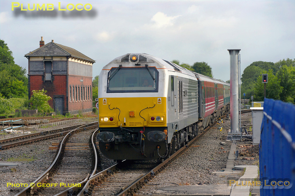 """The second of the morning's LHCS train slows for the stop at Princes Risborough, 67015 """"David J. Lloyd"""" leading the """"hybrid"""" set of coaches with 82302 on the rear. This is 1H08, the 06:53 from Banbury to Marylebone, running a few minutes late at 07:36 on Monday 23rd May 2011. This train has also been running with loco-haulage since December 2010. Digital Image No. GMPI9189."""