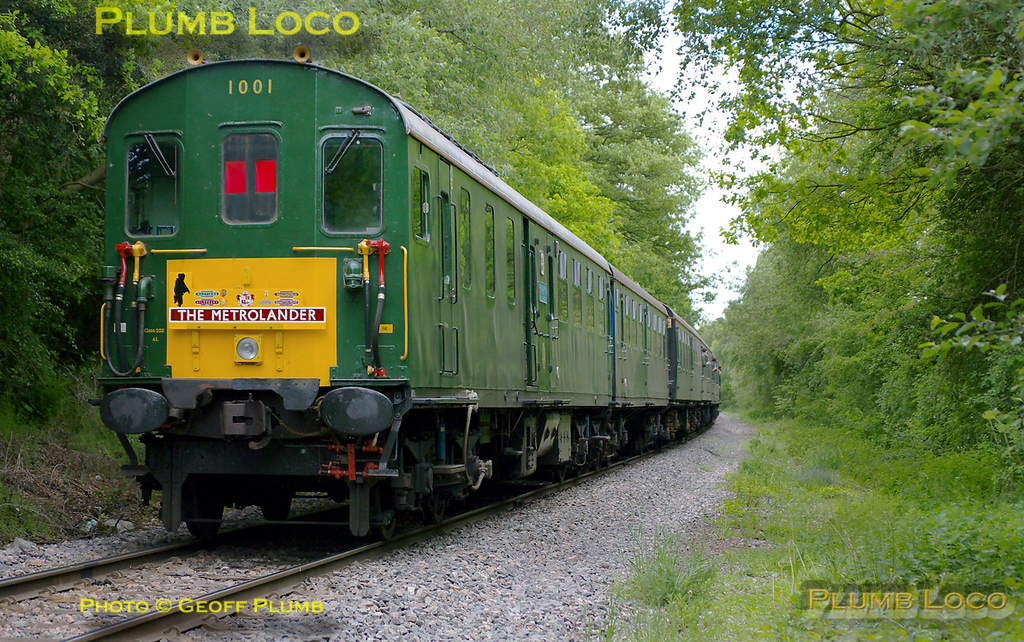 "Hastings ""Thumper"" unit 1001 is now returning from Claydon LNE Junction as 1Z58 to Quainton Road. It is passing through the woods adjacent to the Calvert landfill site. 14:39, Saturday 14th May 2011. Photo taken from a public footpath across the line. Digital Image No. GMPI9052."