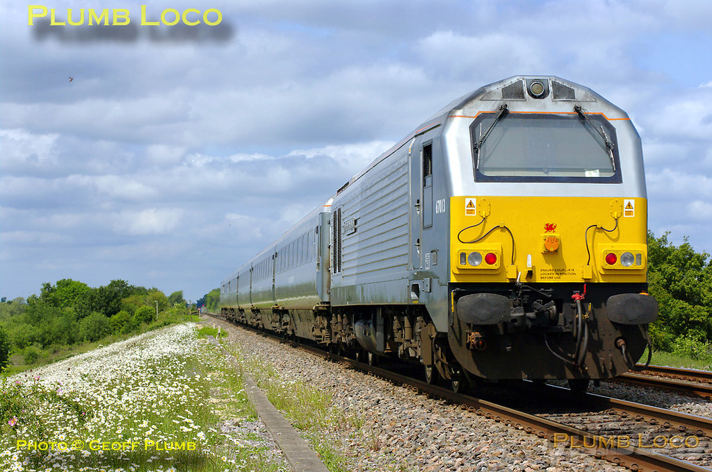 """A few minutes after 5H67 had gone south, northbound 5Z67 passed the foot-crossing at Launton. This is the 11:30 crew training run from Wembley LMD to Hatton with 82305 leading the five coach set with 67013 """"Dyfrbont Pontcysyllte"""" on the rear. 12:13, Thursday 19th May 2011. Digital Image No. GMPI9107."""