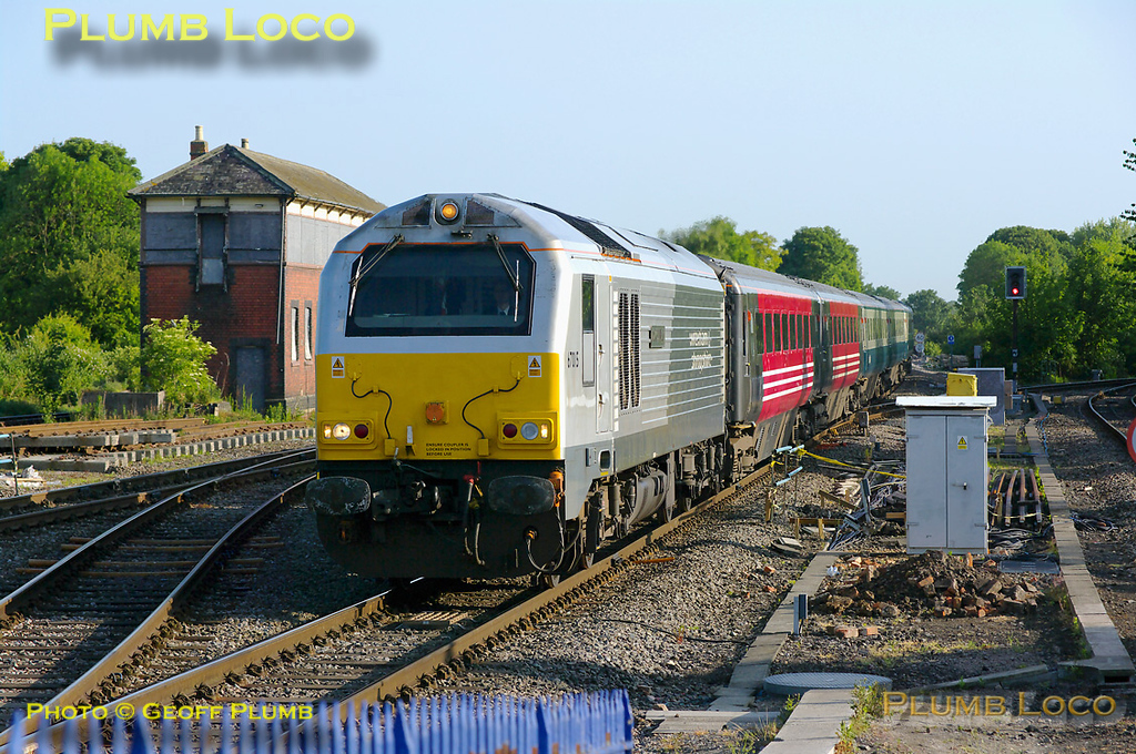"""On a lovely spring morning, 67015 """"David J. Lloyd"""" approaches the stop at Princes Risborough station with 1H08, the 06:53 Banbury to Marylebone Chiltern LHCS. The """"hybrid"""" set has turned once again, the loco again at the south end. This was, as far as I'm aware, the first time in several months that the train has been worked by a silver """"Skip"""", generally having been worked by a hired-in loco. 07:28, Thursday 19th May 2011. Digital Image No. GMPI9090."""