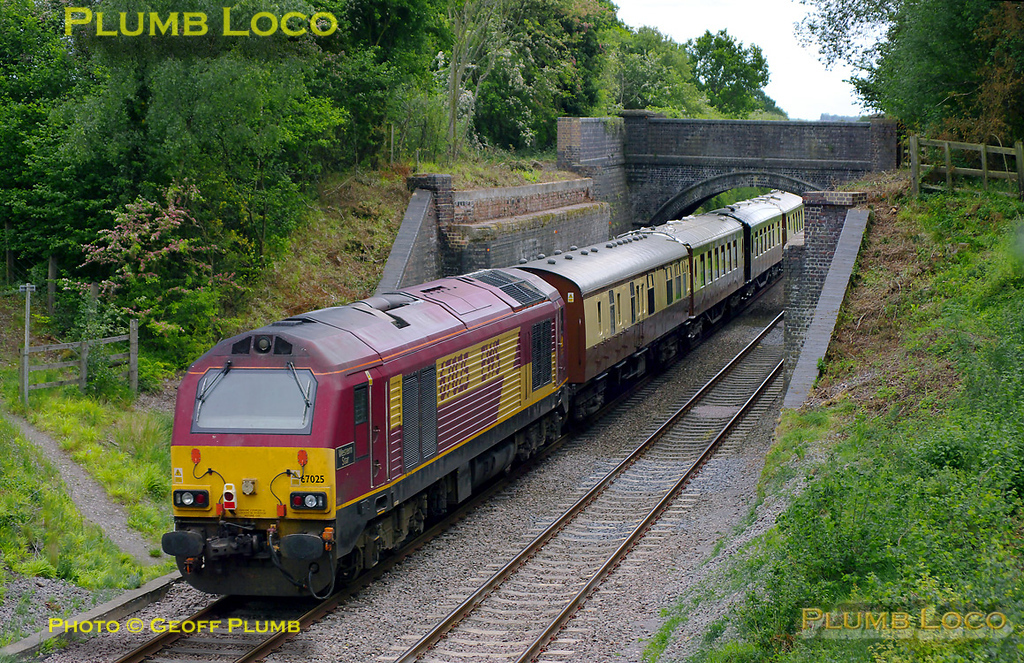 "67025 ""Western Star"" doesn't quite match the pristine stock of the VSOE, here running as ECS, 5Z56 from Banbury to Haddenham & Thame Parkway to pick up its passengers after their visit to Le Manoir aux Quat' Saisons. It is just passing the abutments of the bridge that once carried the Brill Tramway over the GWR line at Wood Siding, now long closed. 16:31, Tuesday 10th May 2011. Digital Image No. GMPI8923."