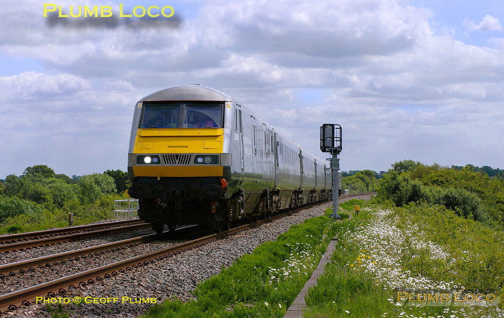 "A few minutes after 5H67 had gone south, northbound 5Z67 is now approaching the foot-crossing at Launton. This is the 11:30 crew training run from Wembley LMD to Hatton with 82305 leading the five coach set with 67013 ""Dyfrbont Pontcysyllte"" on the rear. 12:13, Thursday 19th May 2011. Digital Image No. GMPI9106."