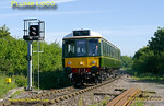 "Green ""bubblecar"" 121 034 is approaching Little Kimble station at 08:10 with the 08:02 from Aylesbury to Princes Risborough. This was its first southbound run with passengers on board, the previous trip being ECS only. Wednesday 25th May 2011. Digital Image No. GMPI9246."